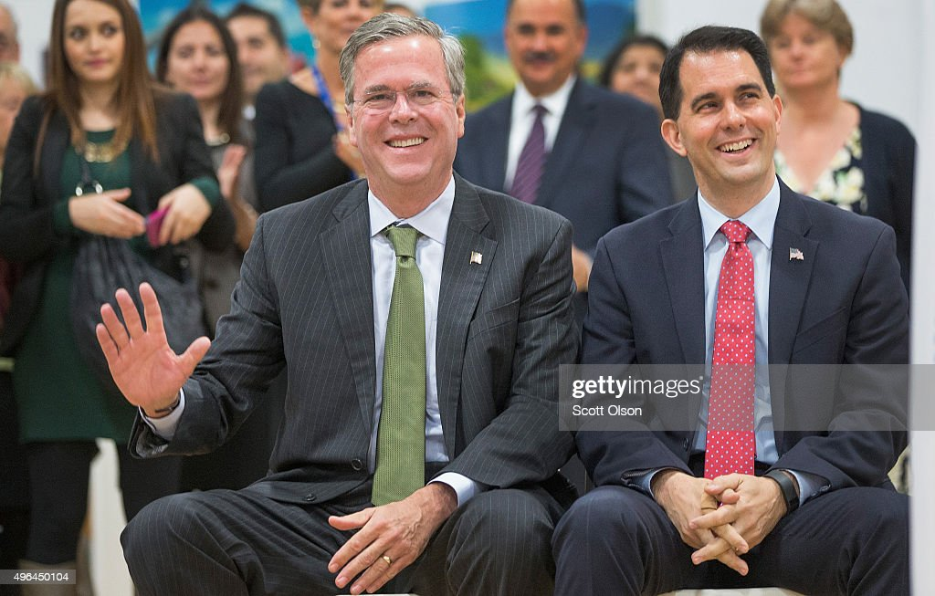 Wisconsin Governor Scott Walker (R) sits with Republican presidential candidate Jeb Bush (L) at La Casa de Esperanza during a campaign stop on November 9, 2015 in Waukesha, Wisconsin. Tomorrow Bush will participate in the third Republican presidential debate sponsored by Fox Business News and the Wall Street Journal at the Milwaukee Theater in nearby Milwaukee.