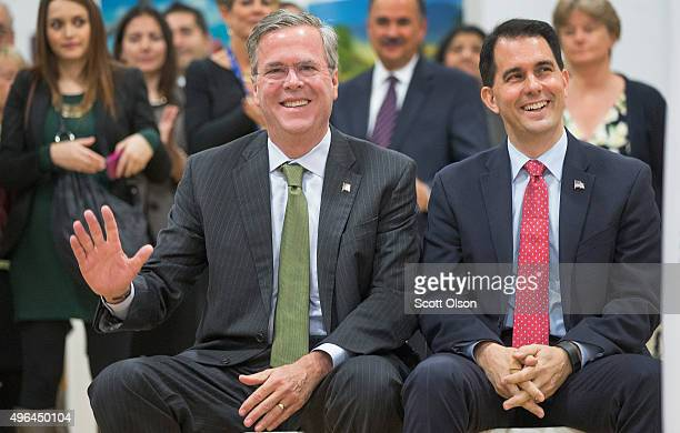 Wisconsin Governor Scott Walker sits with Republican presidential candidate Jeb Bush at La Casa de Esperanza during a campaign stop on November 9...