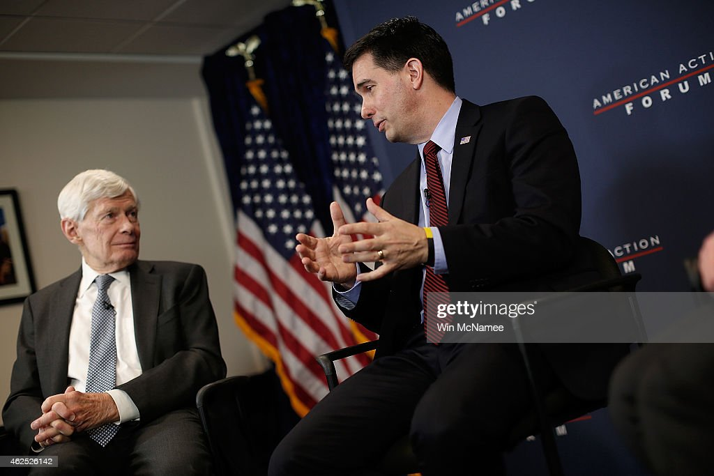 Wisconsin Governor Scott Walker (R) speaks with Fred Malek (L) at the American Action Forum January 30, 2015 in Washington, DC. Earlier in the week Walker announced the formation of 'Our American Revival', a new committee designed to explore the option of a presidential bid in 2016.