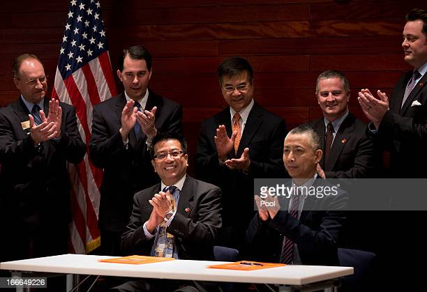 Wisconsin Governor Scott Walker US Ambassador to China Gary Locke applaud after a signing of a Memorandum of Understanding of commercial deals...