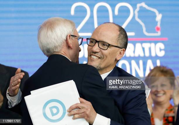 Wisconsin Governor Tony Evers and Chair of the Democratic National Committee Tom Perez hug during a press conference at the Fiserv Forum in...