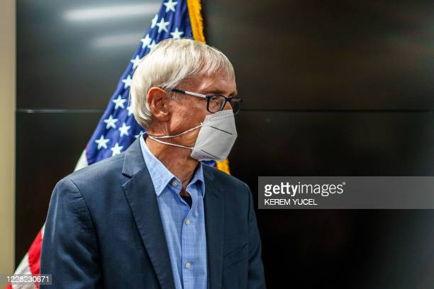 Wisconsin Governor Tony Evers awaits to address the news conference on August 27 2020 in Kenosha Wisconsin A strong police presence brought relative...