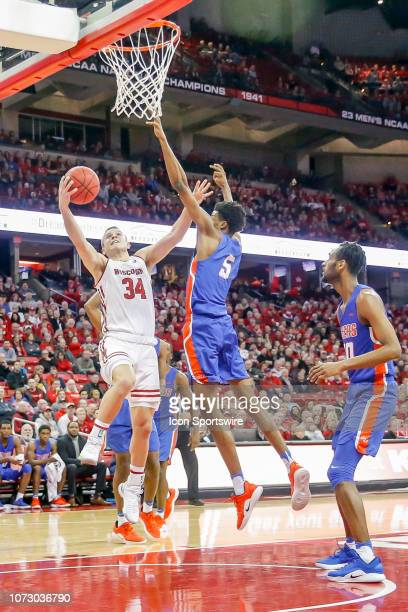 Wisconsin guard Brad Davison attempts a lay up during a college basketball game between the University of Wisconsin Badgers and the Savannah State...