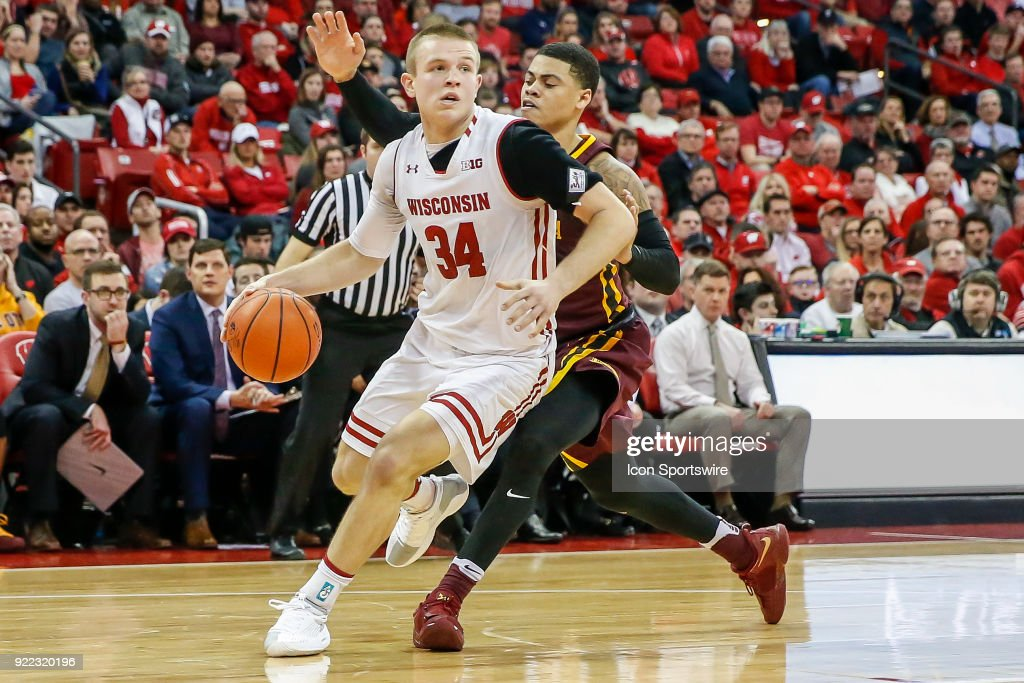 Wisconsin guard Brad Davison (34) dribbles the ball past Minnesota guard Nate Mason (2) during a college basketball game between the University of Wisconsin Badgers and the University of Minnesota Golden Gophers on February 19, 2018 at the Kohl Center in Madison, WI. Wisconsin defeated Minnesota by a score of 73 - 63.