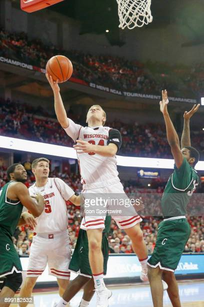 Wisconsin guard Brad Davison goes up for a lay up while Wisconsin forward Nate Reuvers blocks out during a college basketball game between the...