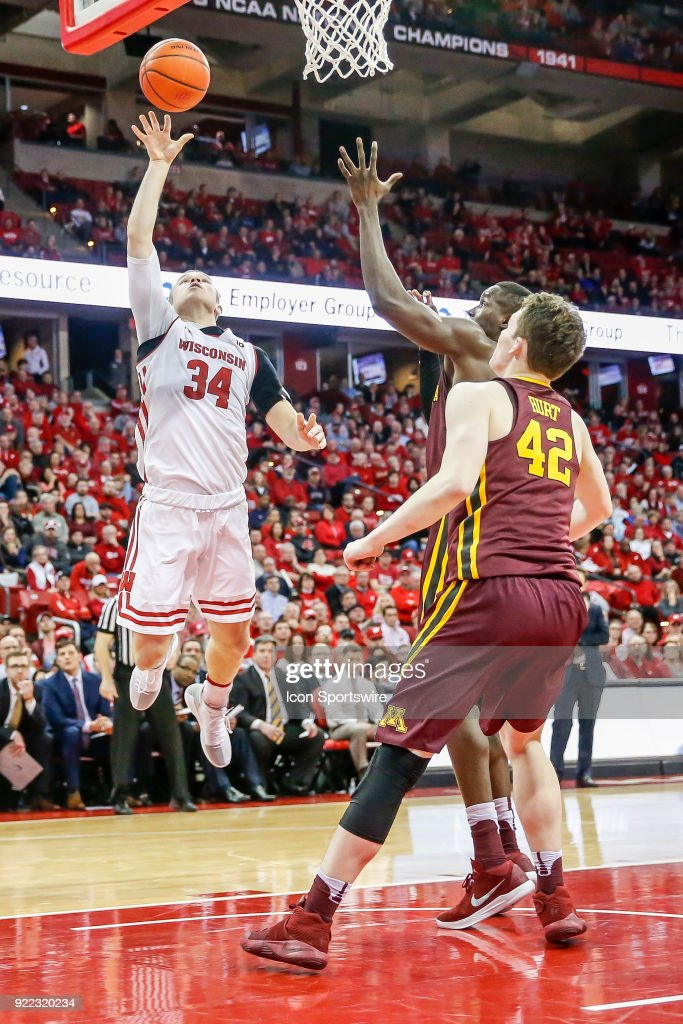 Wisconsin guard Brad Davison (34) puts up a shot while Minnesota forward Michael Hurt (42) looks on during a college basketball game between the University of Wisconsin Badgers and the University of Minnesota Golden Gophers on February 19, 2018 at the Kohl Center in Madison, WI. Wisconsin defeated Minnesota by a score of 73 - 63.