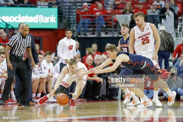 Wisconsin guard Brevin Pritzl and Illinois forward Matic Vesel dive for a loose ball during a college basketball game between the University of...