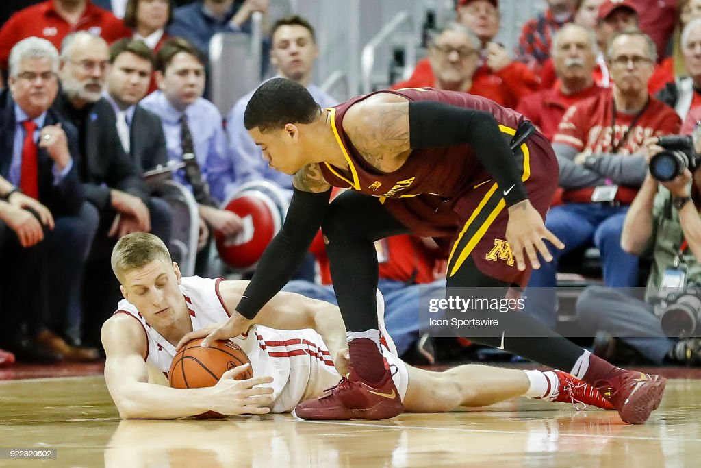 Wisconsin guard Brevin Pritzl (1) and Minnesota guard Nate Mason (2) fight for control of the ball during a college basketball game between the University of Wisconsin Badgers and the University of Minnesota Golden Gophers on February 19, 2018 at the Kohl Center in Madison, WI. Wisconsin defeated Minnesota by a score of 73 - 63.