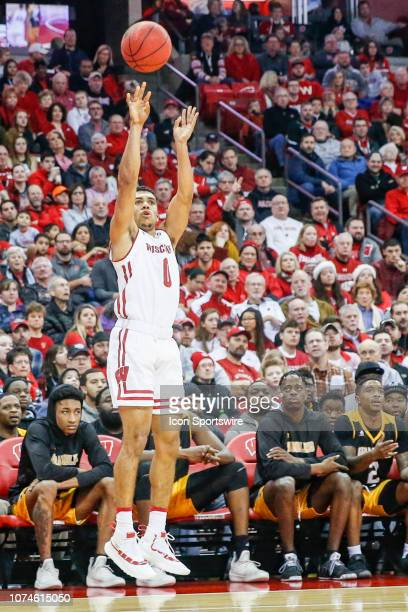 Wisconsin guard D'Mitrik Trice attempts a three point shot during a college basketball game between the University of Wisconsin Badgers and the...