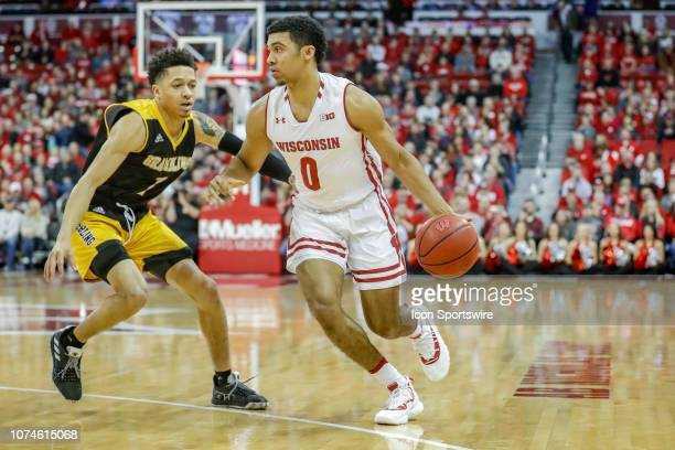 Wisconsin guard D'Mitrik Trice is guarded by Grambling State guard Ivy Smith Jr during a college basketball game between the University of Wisconsin...