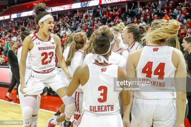 Wisconsin guard Jasmine Hale reacts after confirmation that Wisconsin guard Kelly Karlis' shot at the buzzer was good during a women's college...