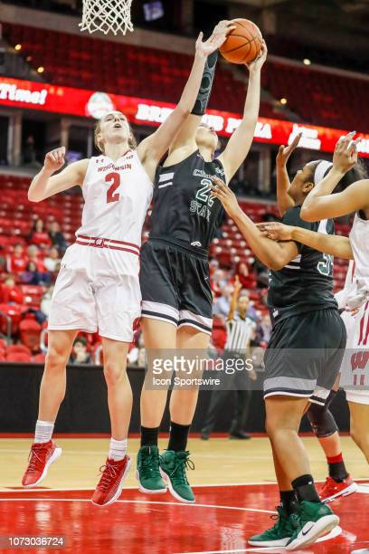 Wisconsin guard Kelly Karlis and Chicago State forward Ines Mata Boix fight for a rebound during a women's college basketball game between the...