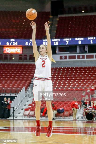Wisconsin guard Kelly Karlis puts up a shot during a women's college basketball game between the University of Wisconsin Badgers and the Marshall...