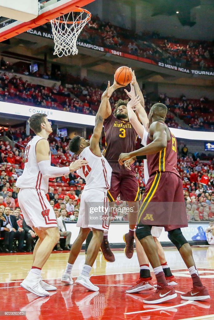 Wisconsin guard Khalil Iverson (21) tries to block the shot by Minnesota forward Jordan Murphy (3) during a college basketball game between the University of Wisconsin Badgers and the University of Minnesota Golden Gophers on February 19, 2018 at the Kohl Center in Madison, WI. Wisconsin defeated Minnesota by a score of 73 - 63.
