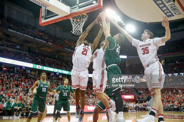 Wisconsin guard Khalil Iverson Wisconsin forward Alex Illikainen Wisconsin forward Nate Reuvers and Chicago State center Patrick Szpir battle for...