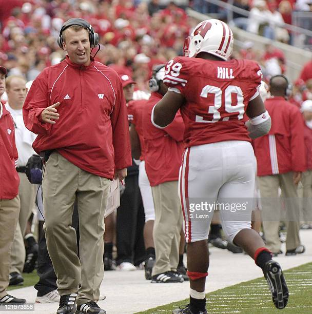 Wisconsin head coach Bret Bielema greets PJ Hill after Hill scored a touchdown during the game between the Wisconsin Badgers and the Western Illinois...