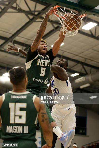 February 25: Wisconsin Herd center Justin Patton dunks the ball as Delaware Blue Coats center Christ Koumadje defends in a NBA G-League game on...