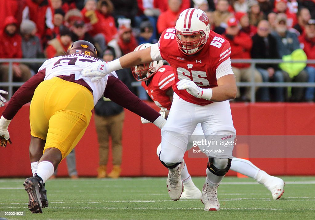Wisconsin offensive lineman Ryan Ramczyk (65) blocks and moves up field during game action. Wisconsin beat Minnesota by a final score of 31-17 at Camp Randall Stadium on November 26, 2016 in Madison, WI.