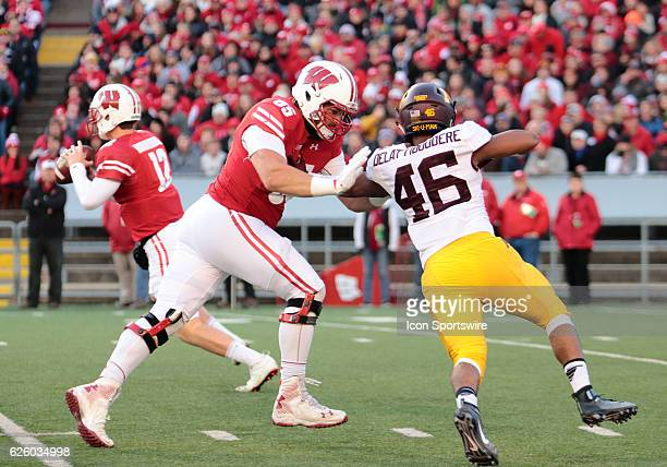 Wisconsin offensive lineman Ryan Ramczyk blocks Minnesota defensive lineman Winston DeLattiboudere during game action. Wisconsin beat Minnesota by a...