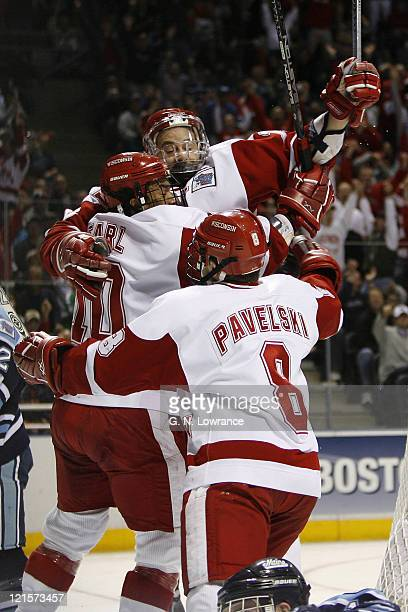 Wisconsin players celebrate a goal by Adam Burish versus Maine during 1st-period action in the semi-finals of the NCAA frozen four at the Bradley...