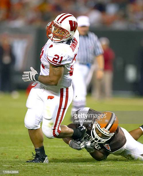 Wisconsin running back Dywon Rowan is tackled versus Bowling Green at Cleveland Browns Stadium Cleveland Ohio September 2 2006 The Badgers defeated...