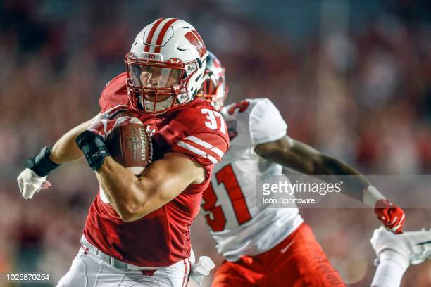 Wisconsin running back Garrett Groshek scores in the fourth quarter during a college football game between the University of Wisconsin Badgers and...