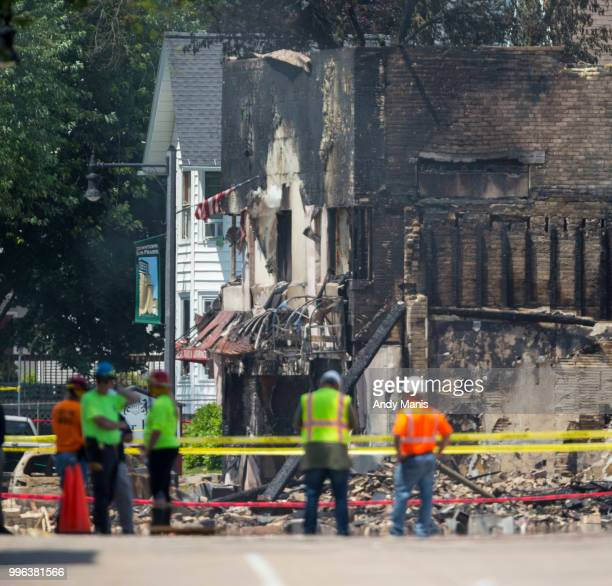 Wisconsin State Fire Marshall investigators stand on Main Street after a gas leak explosion destroyed at least four buildings on July 11 2018 in Sun...