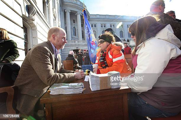 Wisconsin State representative Fred Clark meets with constituents at his desk outside the capitol building March 2, 2011 in Madison, Wisconsin. Clark...