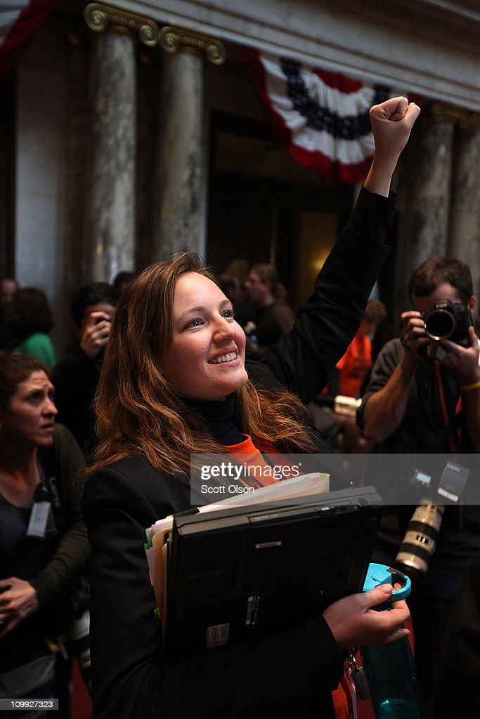 Wisconsin State Representative Kelda Helen Roys gestures to spectators in the Assembly Chamber following a 53-42 vote which essentially eliminated collective bargaining rights for public union workers except on wage issues on March 10, 2011 in Madison, Wisconsin. Thousands of demonstrators took over the Capitol last night following the Senate vote on the bill which passed with no Democrats present.