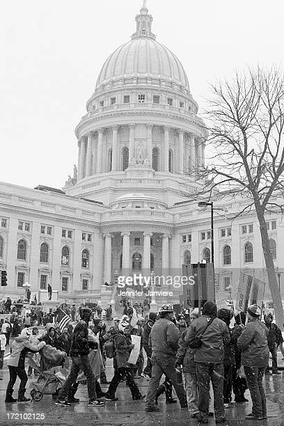 Wisconsin workers and supporters march in protest against the state government's attempts to pass anti collective bargaining legislation.