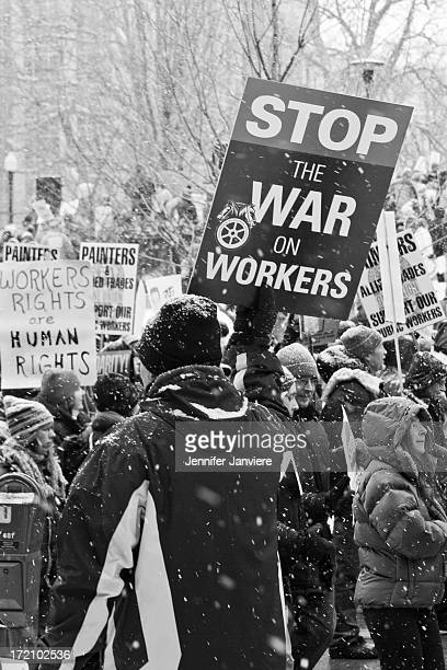 Wisconsin workers and supporters march in protest against the state government's attempts to pass anti union legislation.