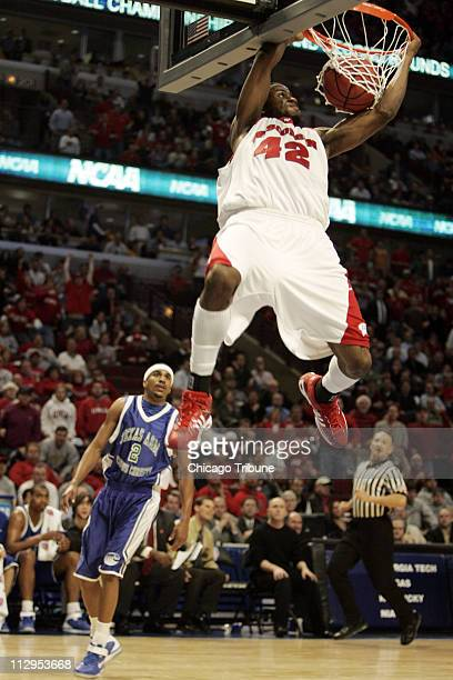 Wisconsin's Alando Tucker slam dunks the ball against Texas AM Corpus Christi during action in a first round game of the NCAA Tournament Wisconsin...