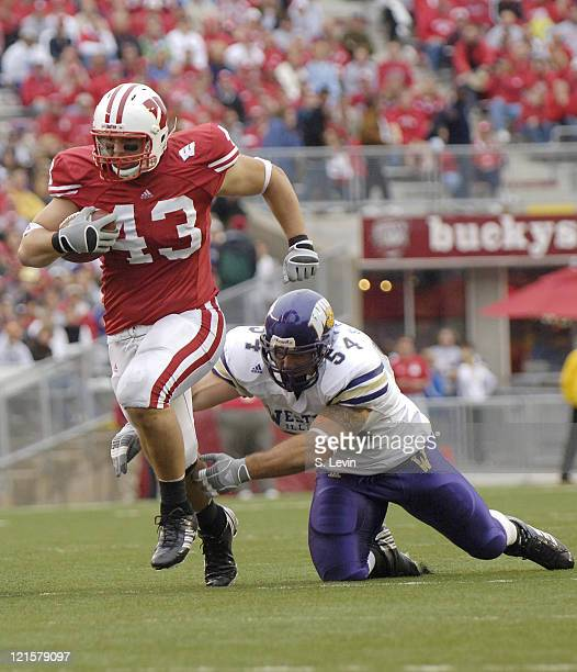 Wisconsin's Andy Crooks gets past a defender and runs it in for a touchdown during the game between the Wisconsin Badgers and the Western Illinois...
