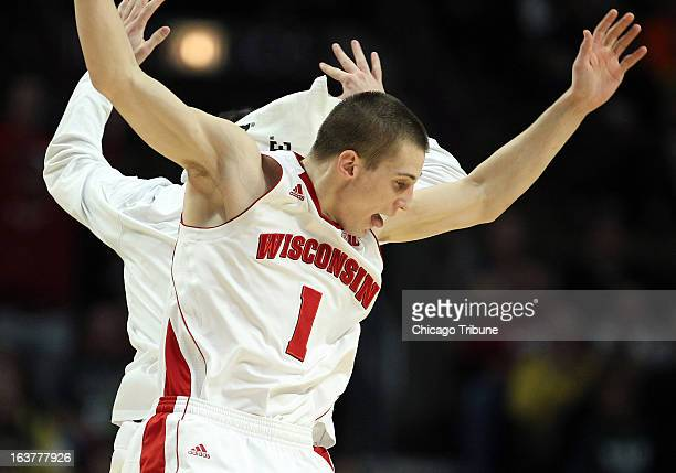Wisconsin's Ben Brust celebrates with a teammate after hitting a threepoint basket against Michigan at the Big Ten Tournament at the United Center in...