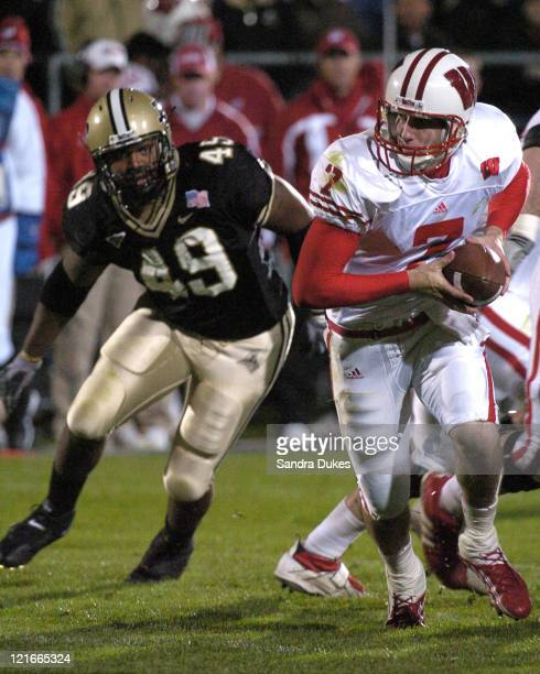 Wisconsin's John Stocco looks to hand off as Anthony Spencer closes in in Wisconsin's 20-17 win over Purdue in Ross Ade Stadium.