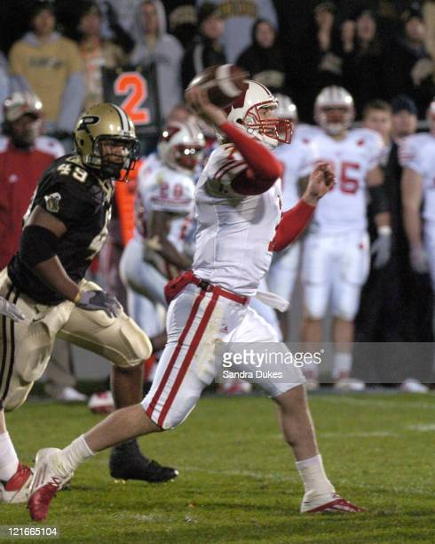 Wisconsin's John Stocco passes as Anthony Spencer closes in in Wisconsin's 20-17 win over Purdue in Ross Ade Stadium.
