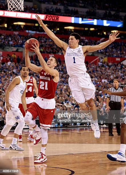 Wisconsin's Josh Gasser scores in front of Kentucky's Devin Booker during the second half in the NCAA Tournament national semifinal at Lucas Oil...