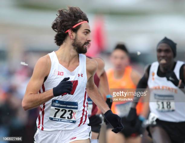 Wisconsin's Morgan McDonald looks back to check other runner as he gets ready to cross the finish line during the Division I Men's Cross Country...