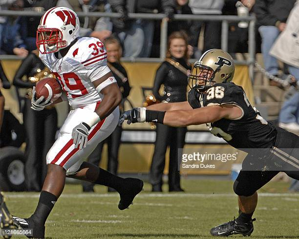 Wisconsin's RB PJ Hill runs from scrimmage and out runs Purdue's LB Dan Bick in Wisconsin's 243 win over Purdue in Ross Ade Stadium West Lafayette IN...