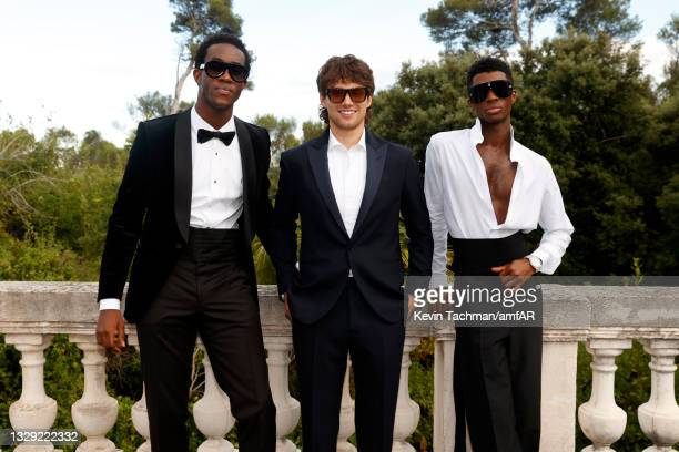 Wisdom Kaye, William White and Alton Mason attend the amfAR Cannes Gala 2021 at Villa Eilenroc on July 16, 2021 in Cap d'Antibes, France.