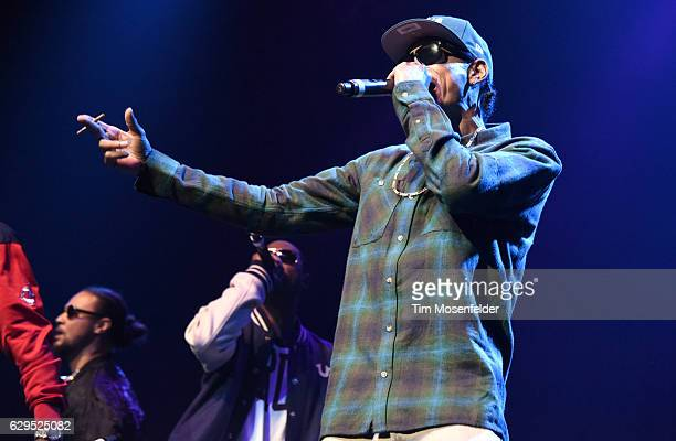 Wish Bone Bizzy Bone and Krayzie Bone of Bone ThugsNHarmony perform during the Snoop Dogg's Puff Puff Pass Tour at Fox Theater on December 12 2016 in...