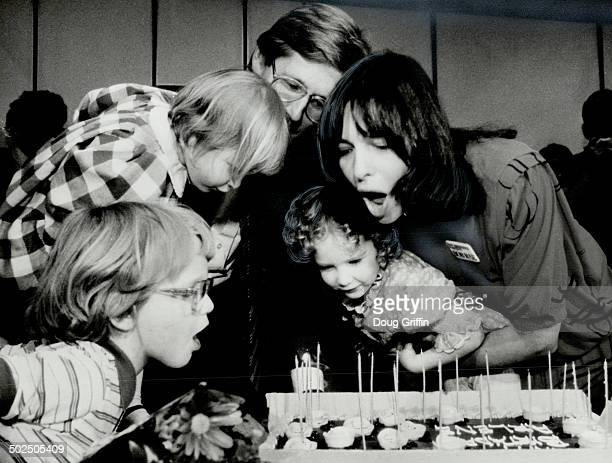 A wish for dad Arlene Perley Rae right celebrates her birthday yesterday with her husband NDP leader Bob Rae adn children Lisa left rear and Judith...
