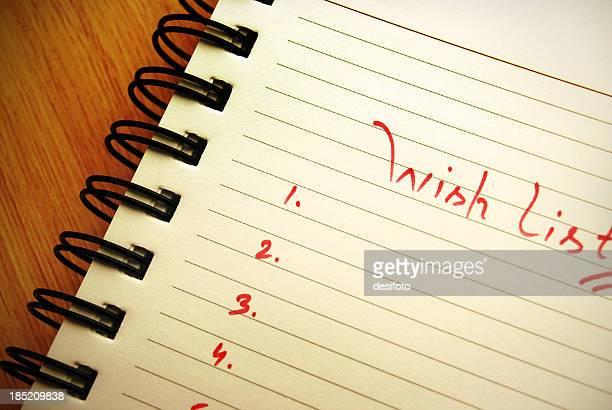 'Wish list' written on a spiral pad