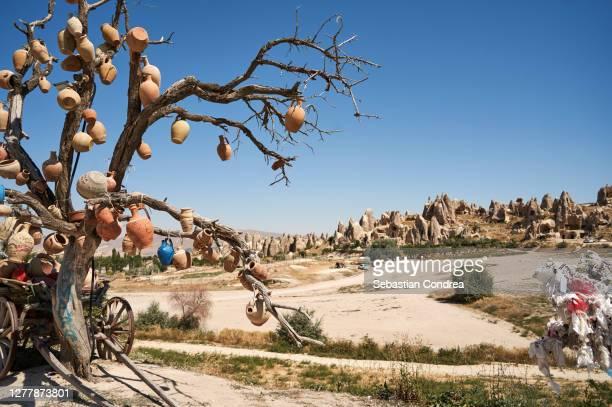 wish tree near the three graces (three beautifuls) rock hills in devrent valley in cappadocia, nevsehir, turkey. - ネヴシェヒル県 ストックフォトと画像