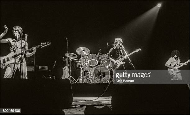 Wishbone Ash performing on stage at Hammersmith Odeon London November 1976 LR Martin Turner Andy Powell Laurie Wisefield