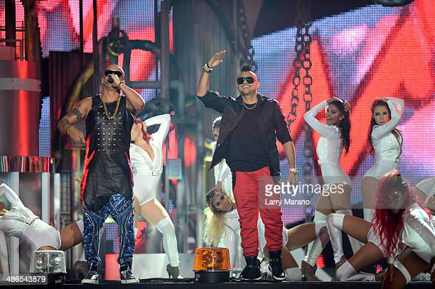 Wisin and Sean Paul perform onstage during the 2014 Billboard Latin Music Awards at Bank United Center on April 24 2014 in Miami Florida