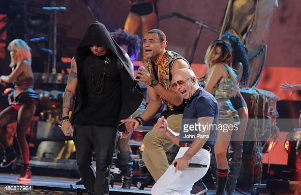 Wisin Mohombi and Pitbull perform onstage during Univision's Premios Juventud 2015 rehearsal at Bank United Center on July 15 2015 in Miami Florida