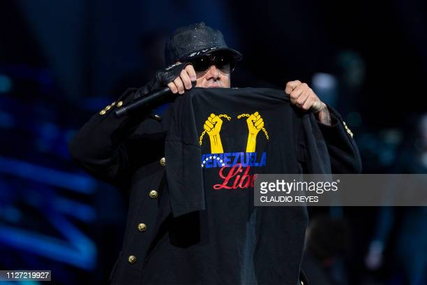 Wisin of Puerto Rican Wisin Yandel duo shows a Tshirt reading Free Venezuela as he performs during the 60th Vina del Mar International Song Festival...