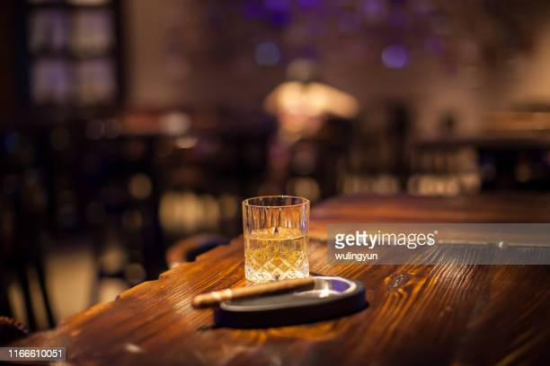 wisky and cigar on bar counter - focus on background stock pictures, royalty-free photos & images