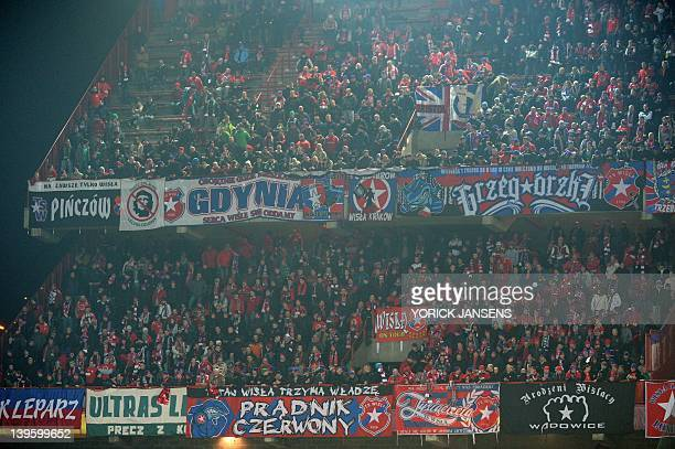 Wisla Krakow's supporters stand during an UEFA Europa League round of 32 football match between Standard de Liege and Wisla Krakow on February 23...